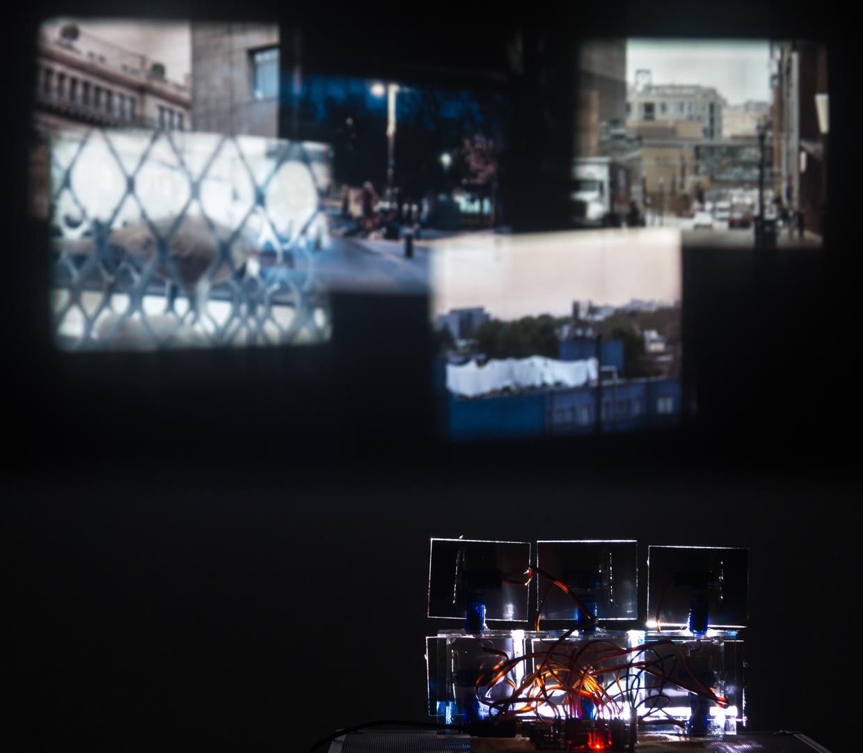 Twelve servo motors distribute one six video projection into sections causing them to separate and overlap at different randomiz