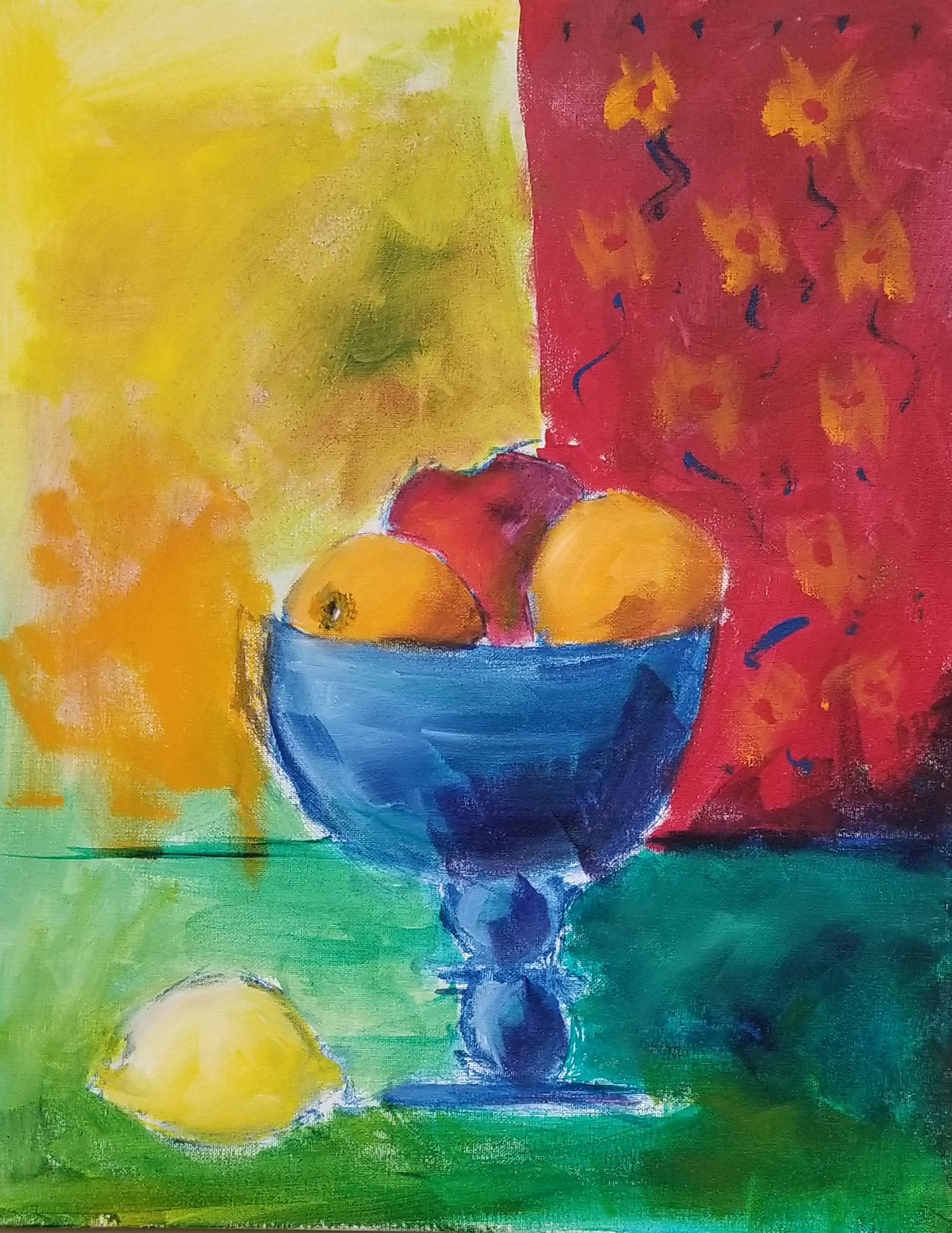 Blue footed fruit bowl with oranges and apple set in a brightly colored room