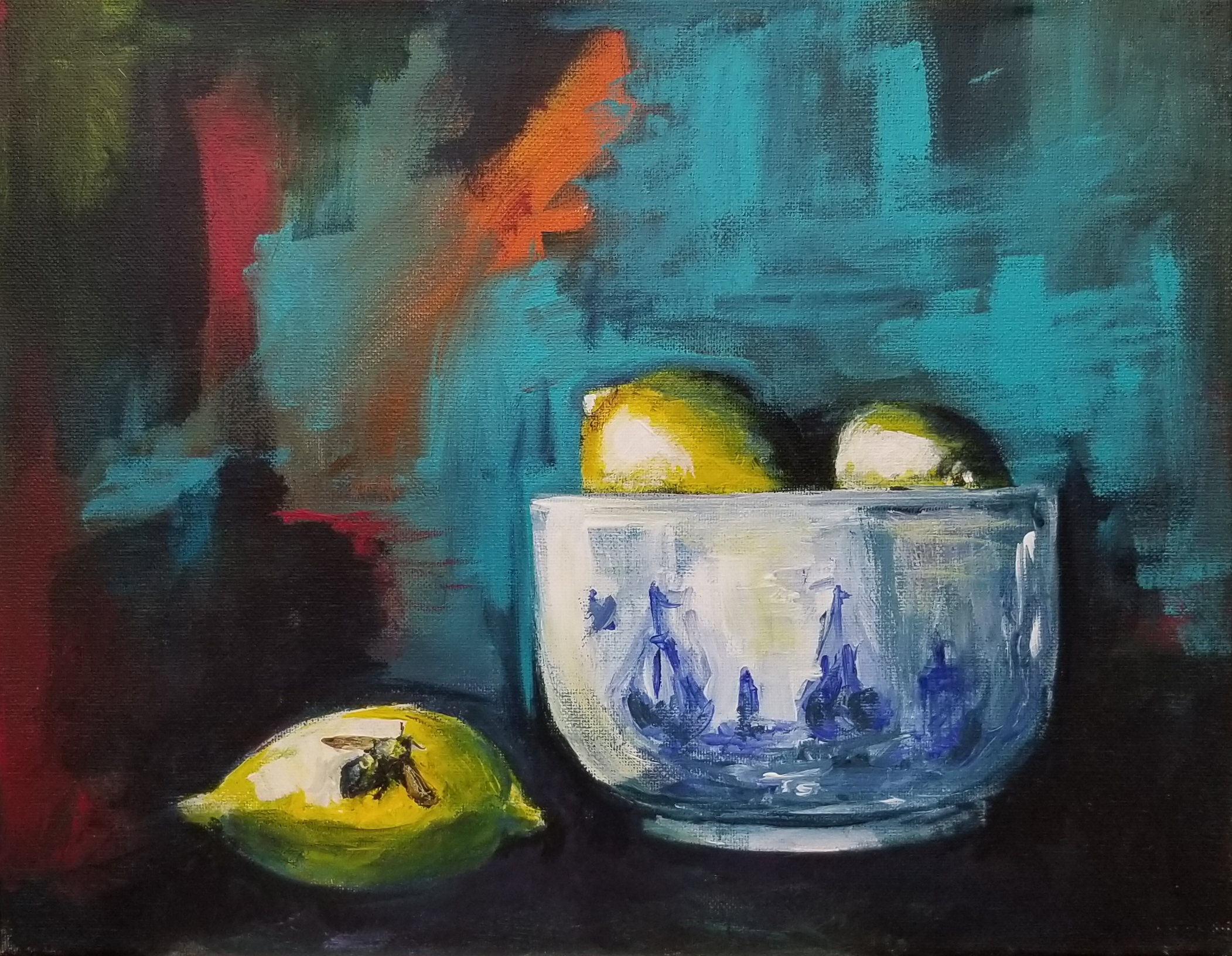 Stilllife with lemons in a small blue and white delft bowl. A small bee sits atop a lemon on the table top.