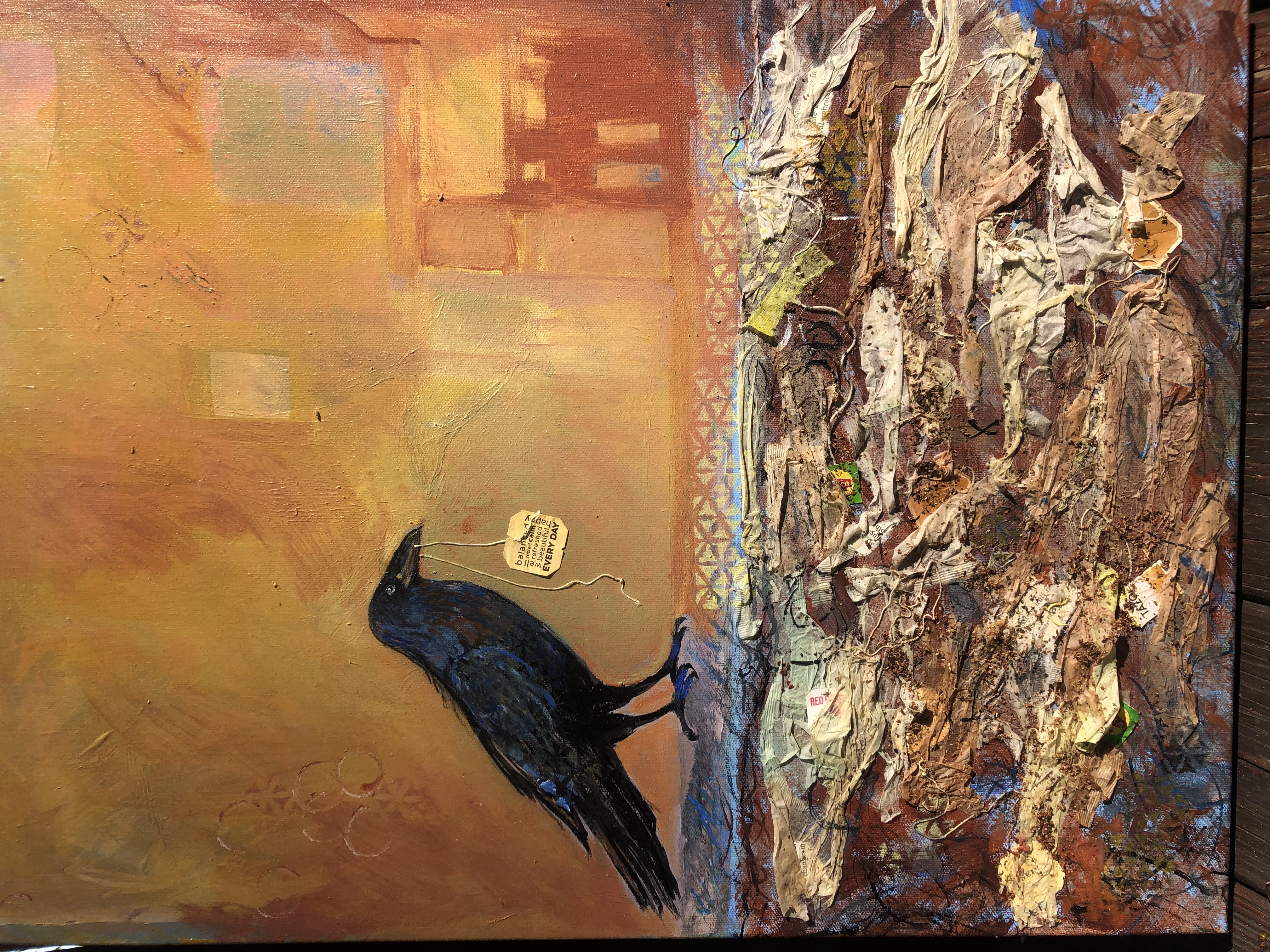 Tea bag collage and acrylic, stencils, Orange background with Raven.