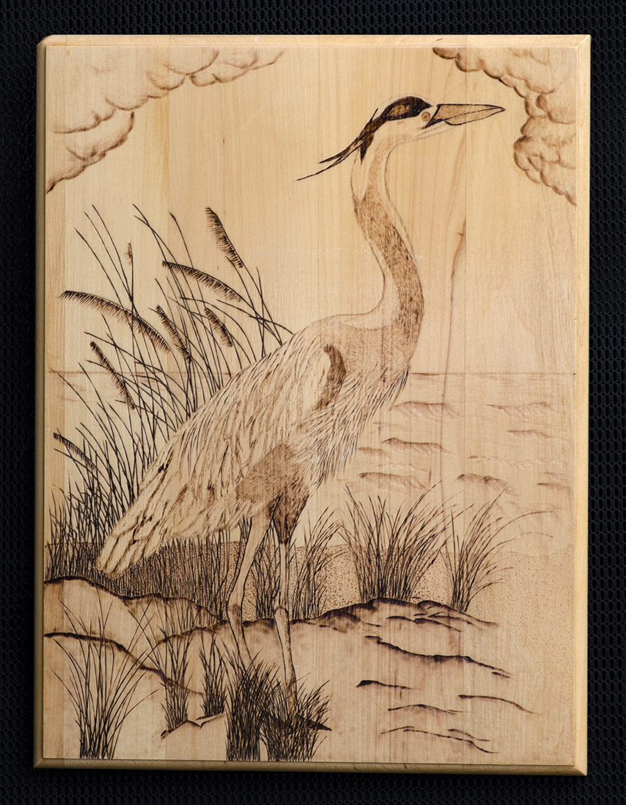 The Blue Heron by the River is a unique, handmade wood burned art