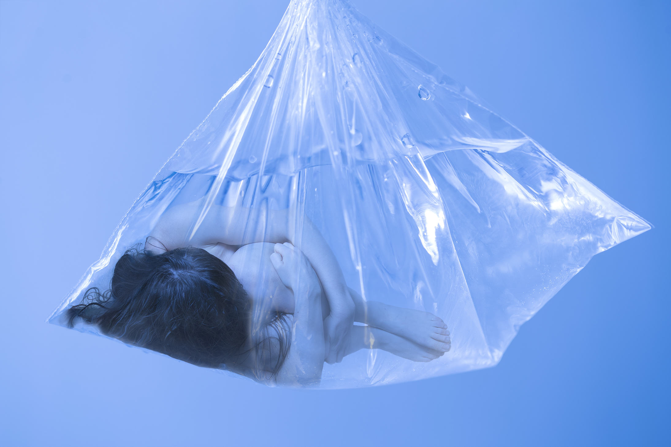 Portrait of a person inside of a plastic bag with water
