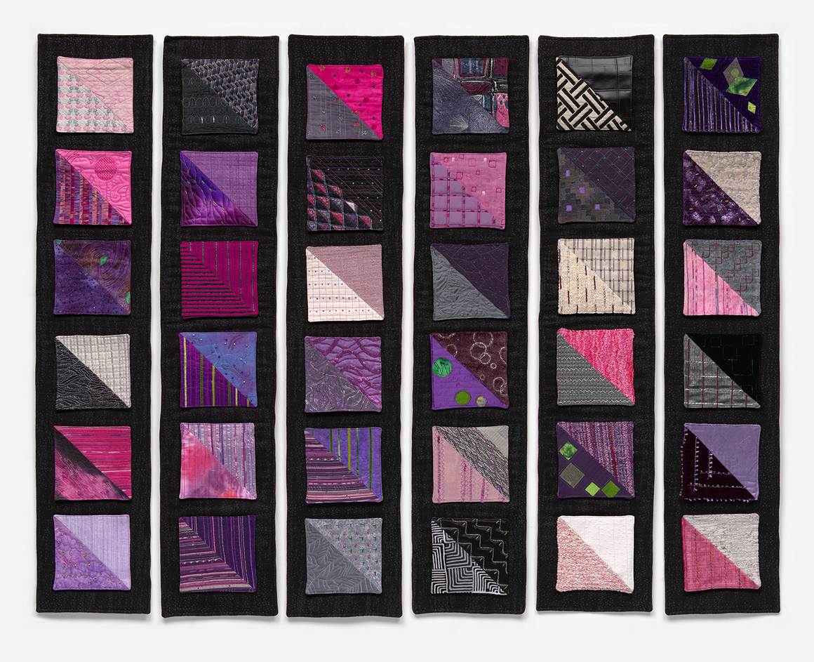 6 panels each with 6 small quiltlets attached by snaps to showcase different fabrics