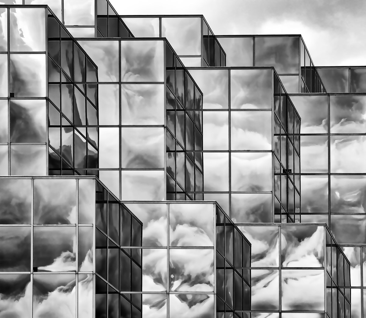 Cloudy Day - Glass building reflecting clouds - black and white
