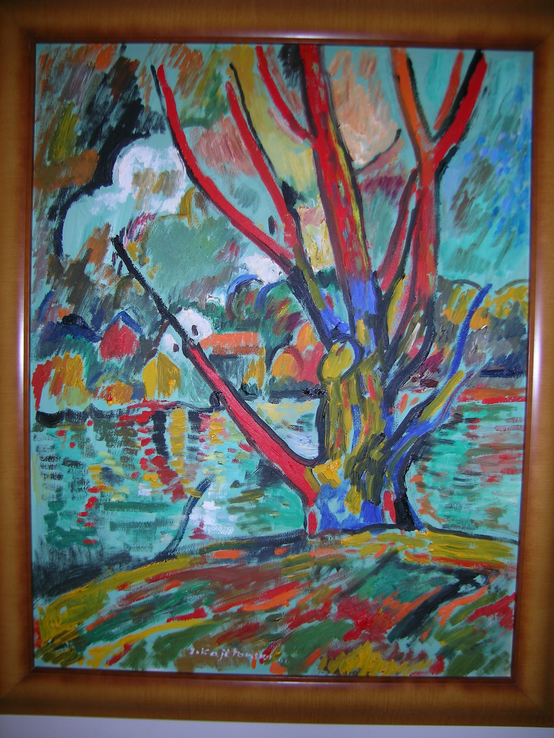 Expressionistic image of willow with the lake and houses in the background. Large clouds in the sky.