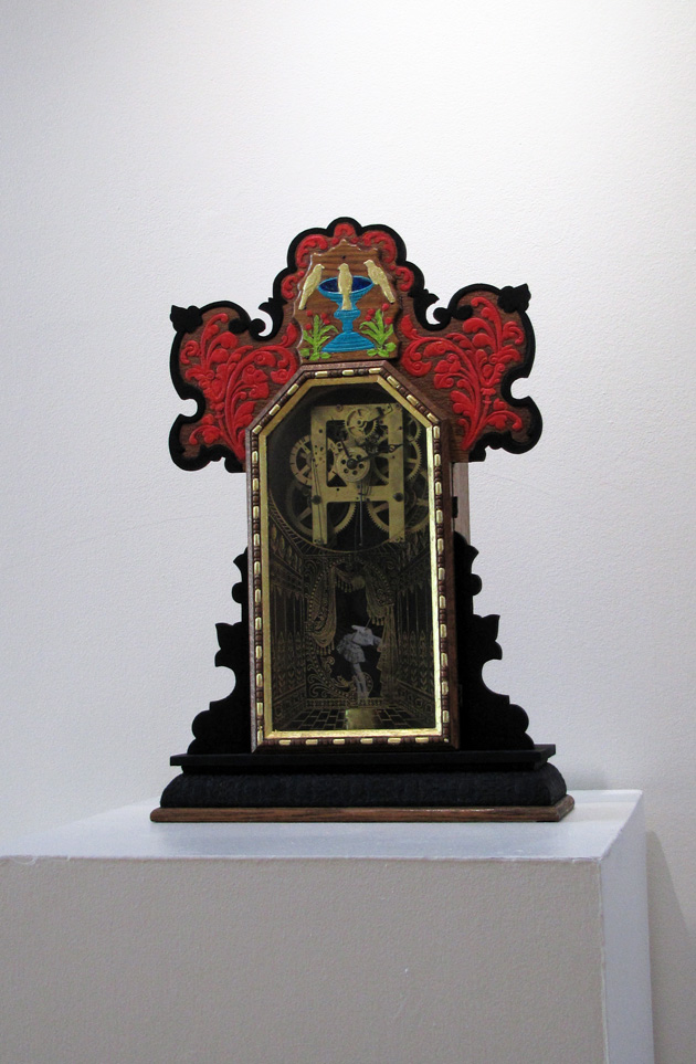 Hand-painted antique clock case with a glass front that has a gold stage painted on it. There is a ballerina with 4 leaf clover