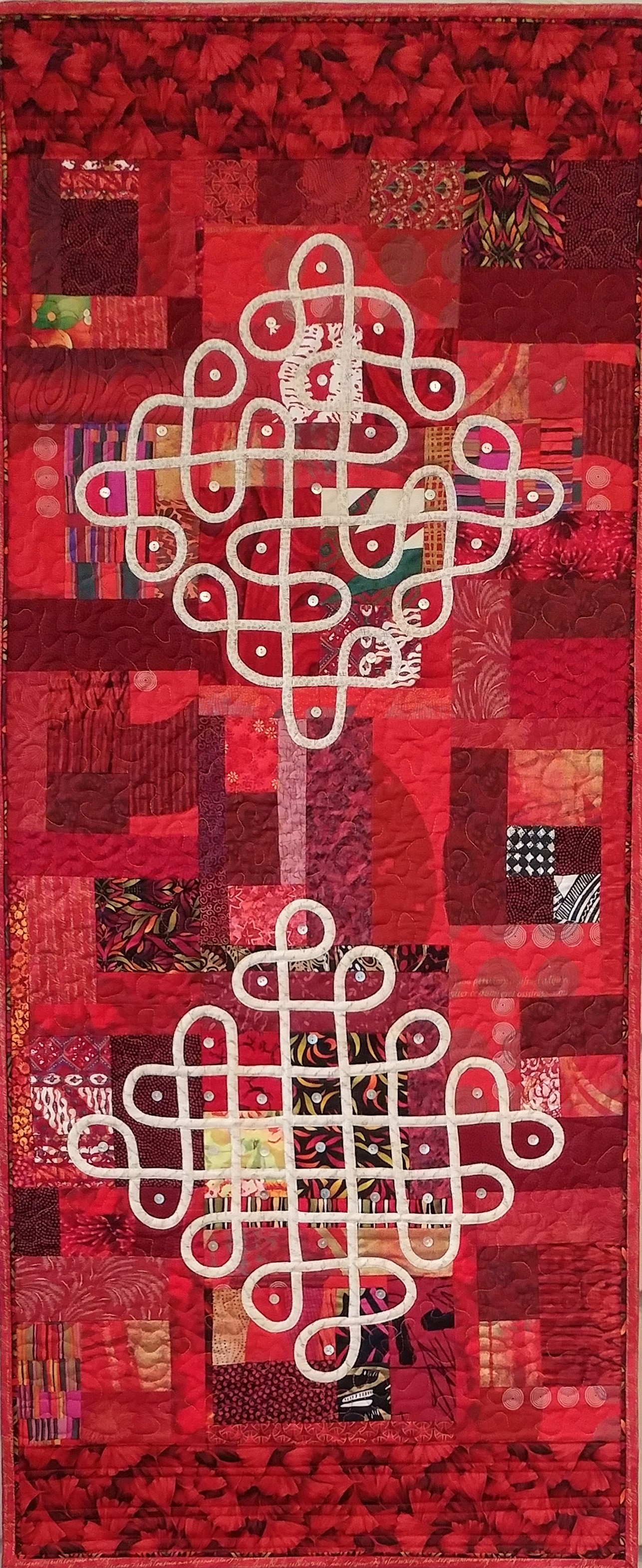 Contemporary RED Quilt with continuous line motifs