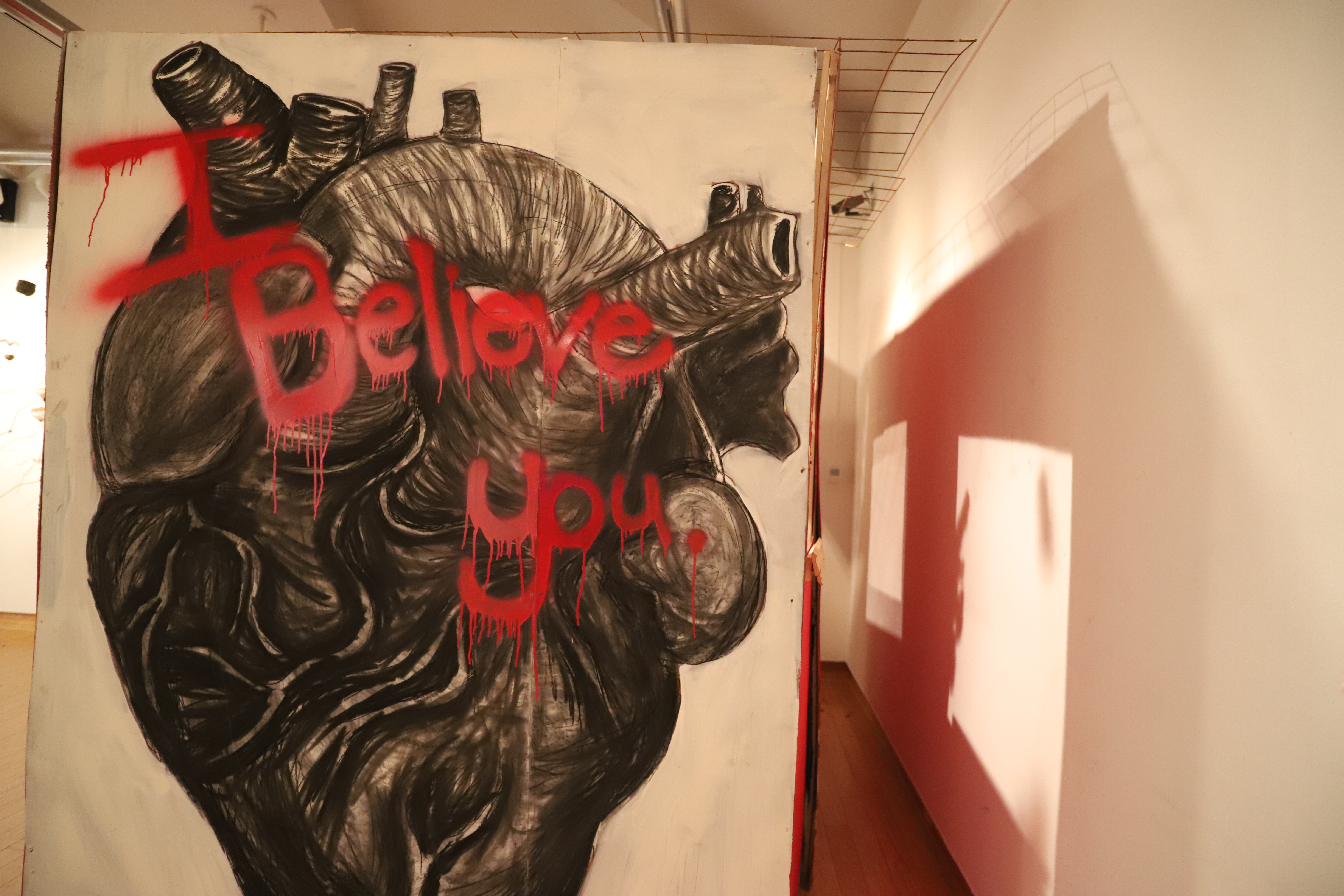 I believe you written in charcoal on a large wall