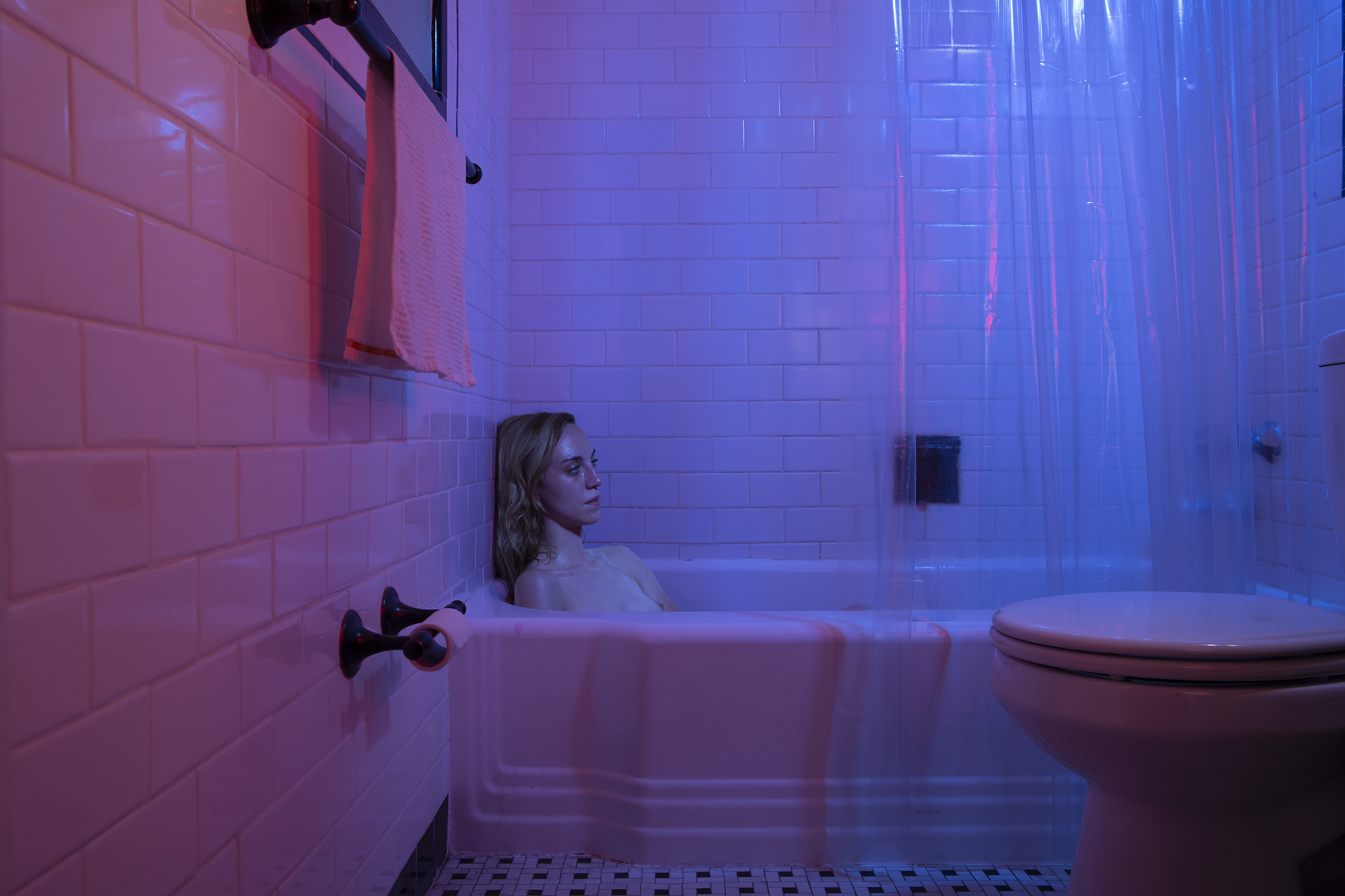 Woman sitting in bath tub