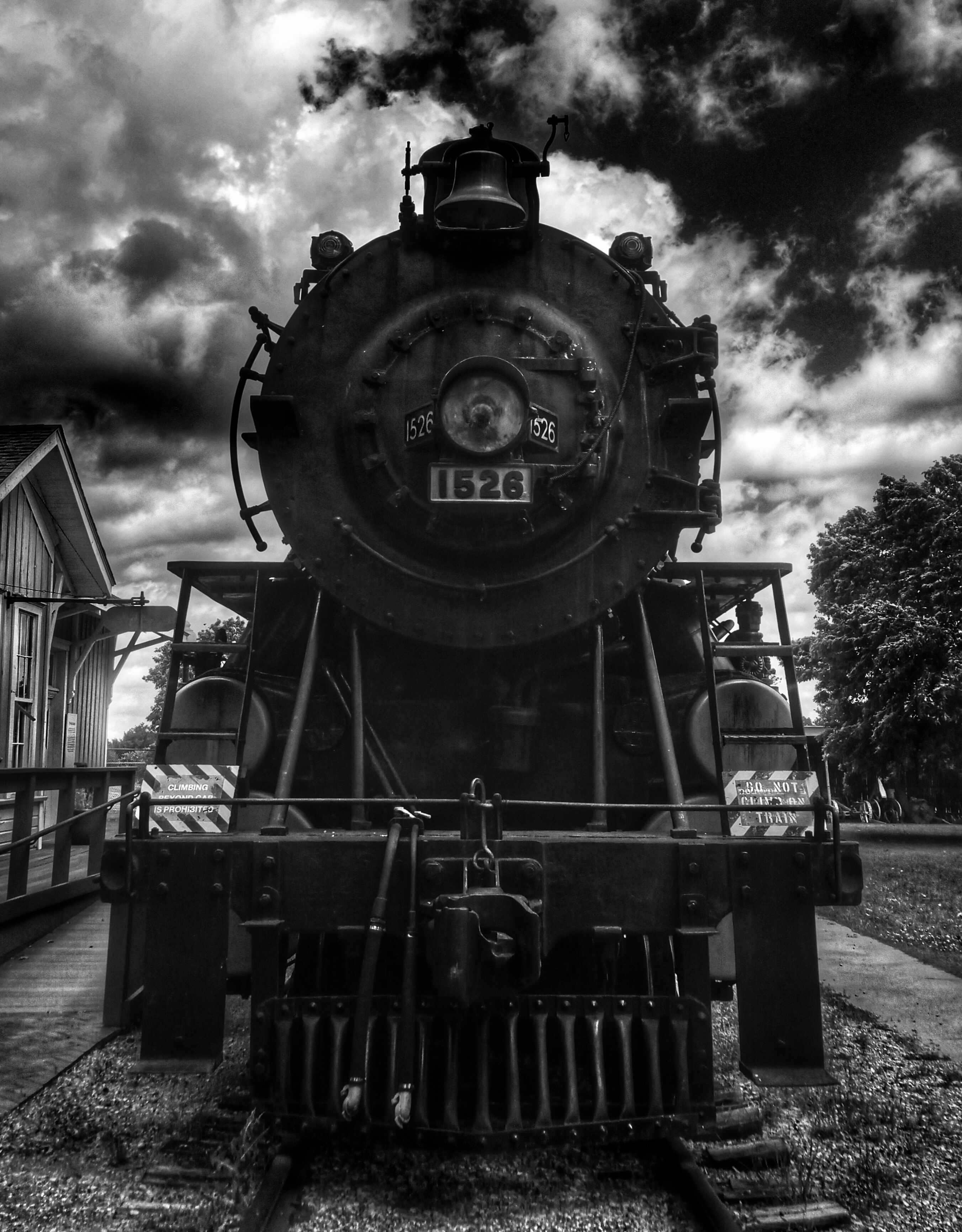 Black and white photo close up of a decomissioned locomotive