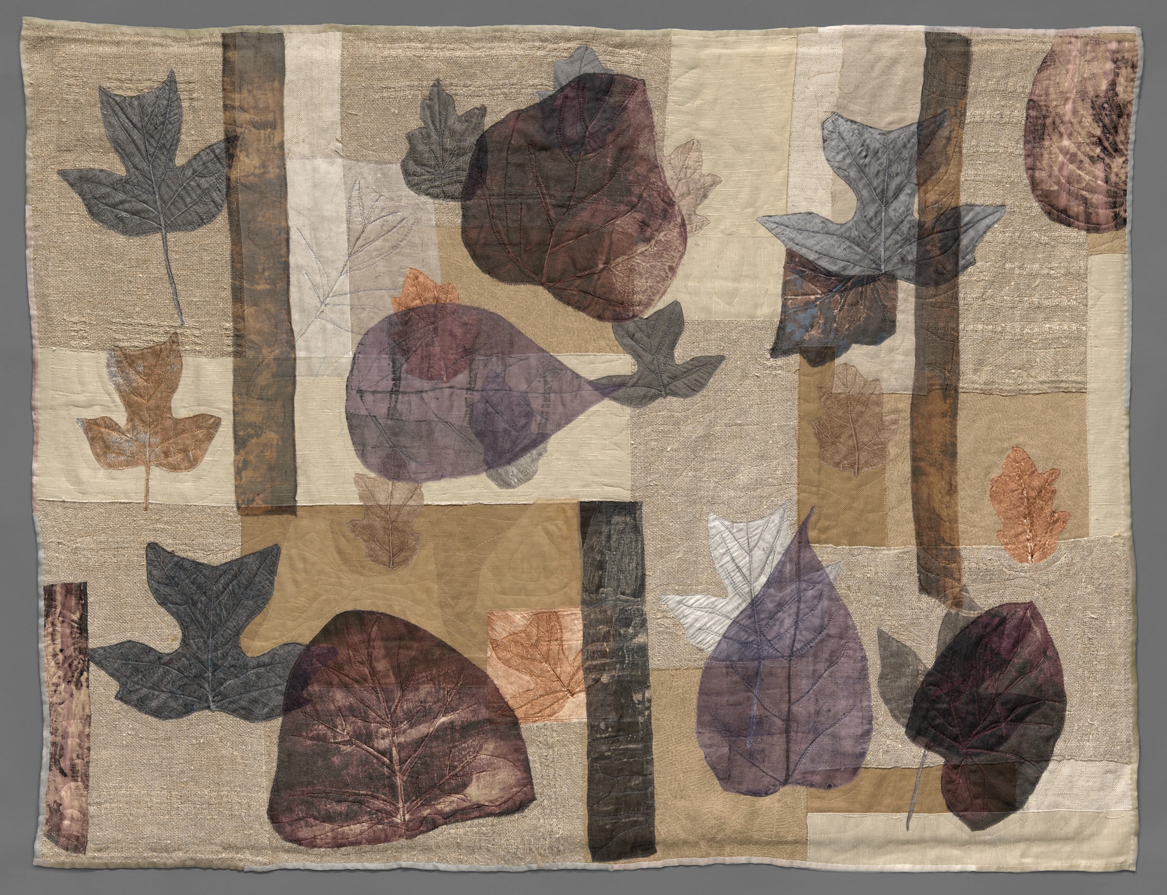 repurposed linen textiles appliqued with collagraph printed leaves