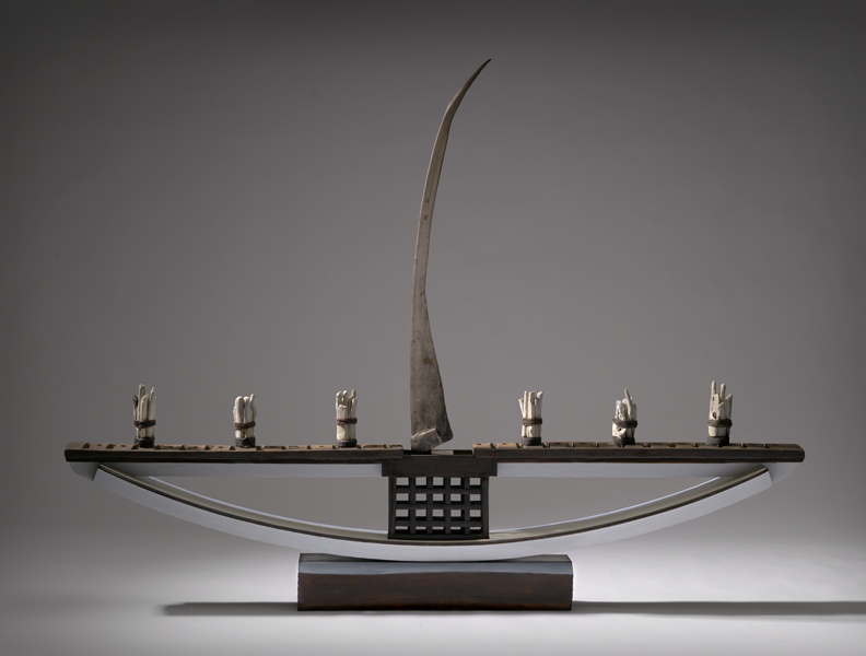 Assemblage - boat with scythe as sail