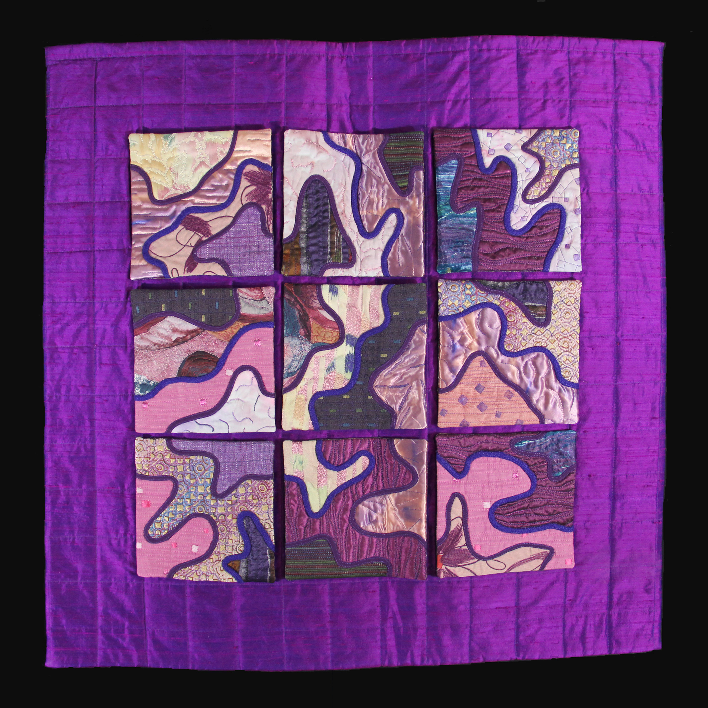 9 individual quiltlets attached by snaps that can be moved to other locations allowing lines to be connected differently