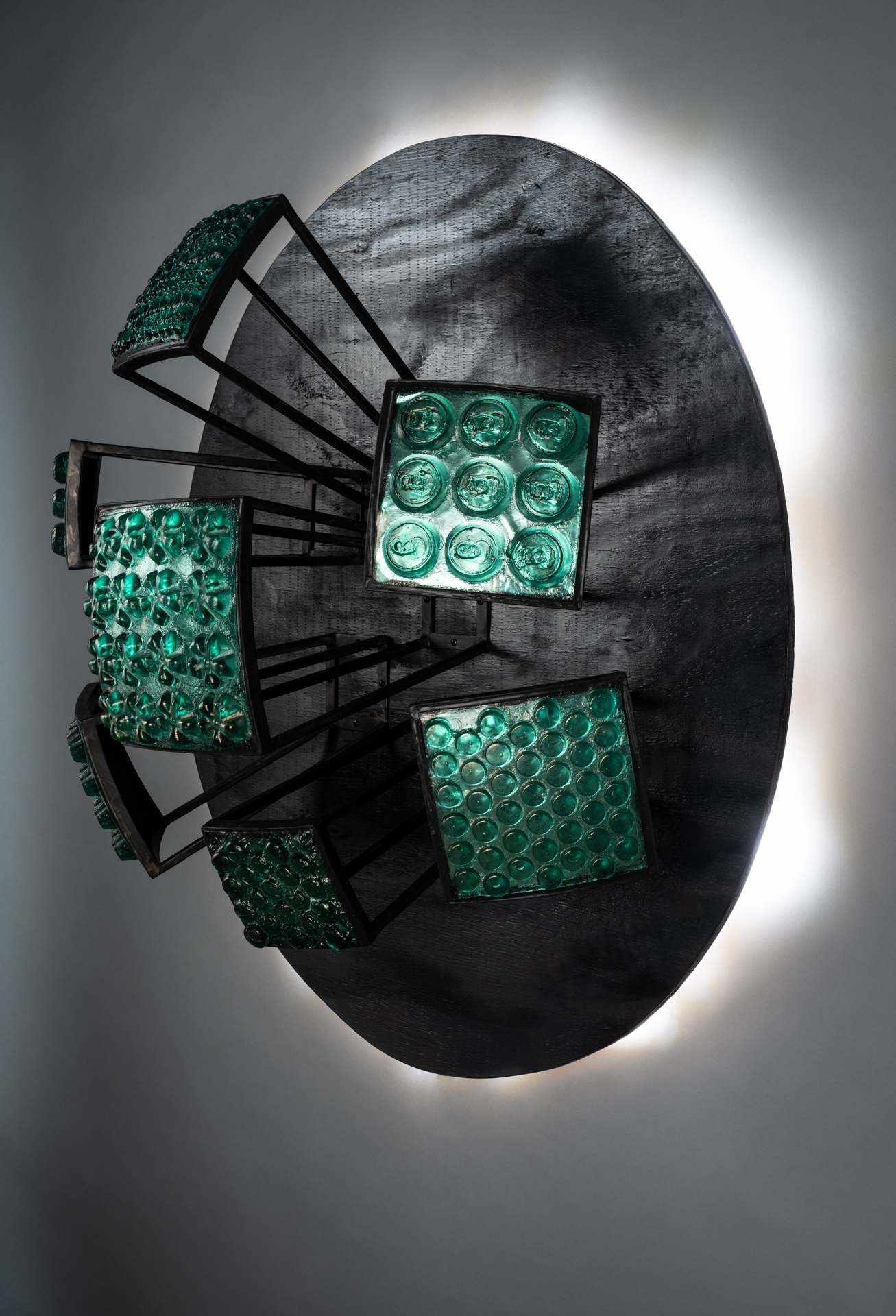 Wall sculpture from recycled glass, steel and wood