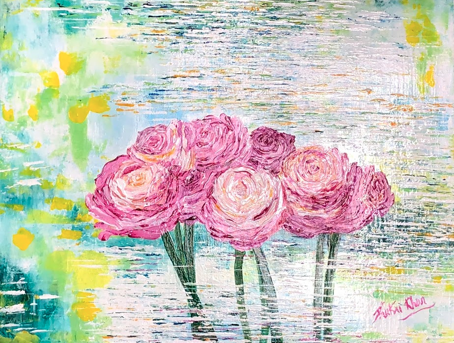 Pink Roses reflecting on a flowing stream.