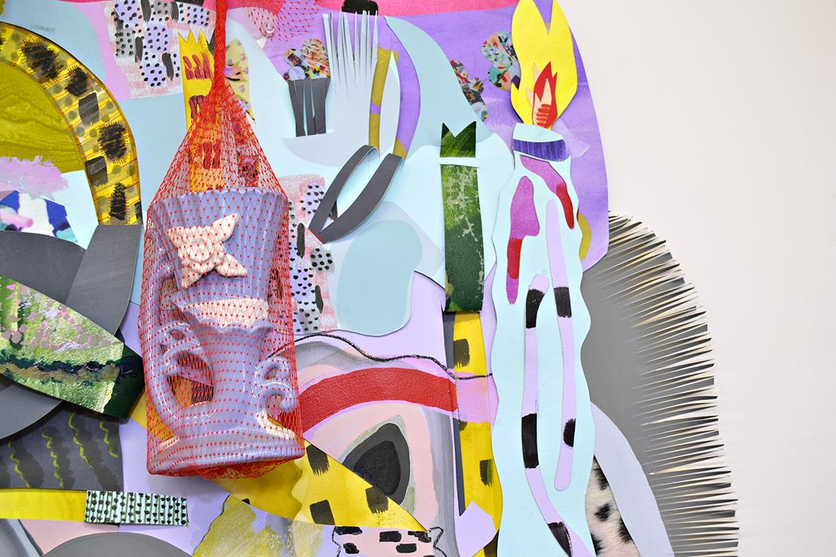 "Detail of the piece ""Shop Til you Drop"" featuring cut paper and collage elements, as well as found object."