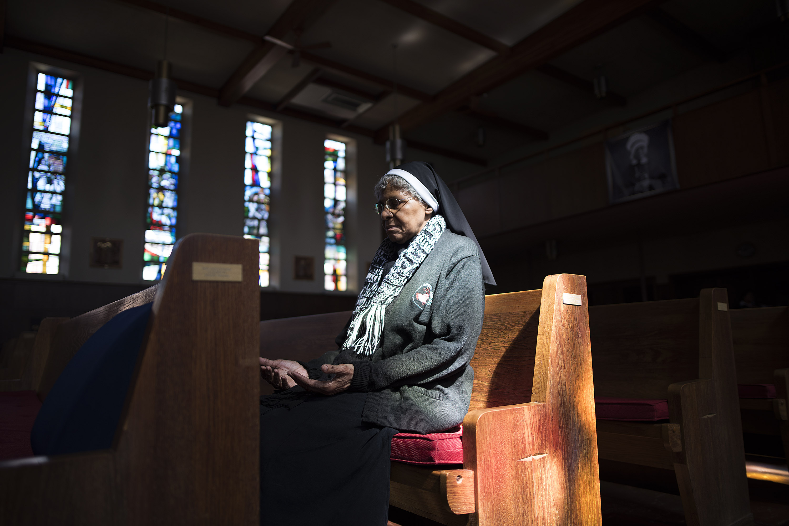 A nun in prayer at the Oblate Sisters Convent in Baltimore, the oldest African-American Roman Catholic sisterhood in the world.
