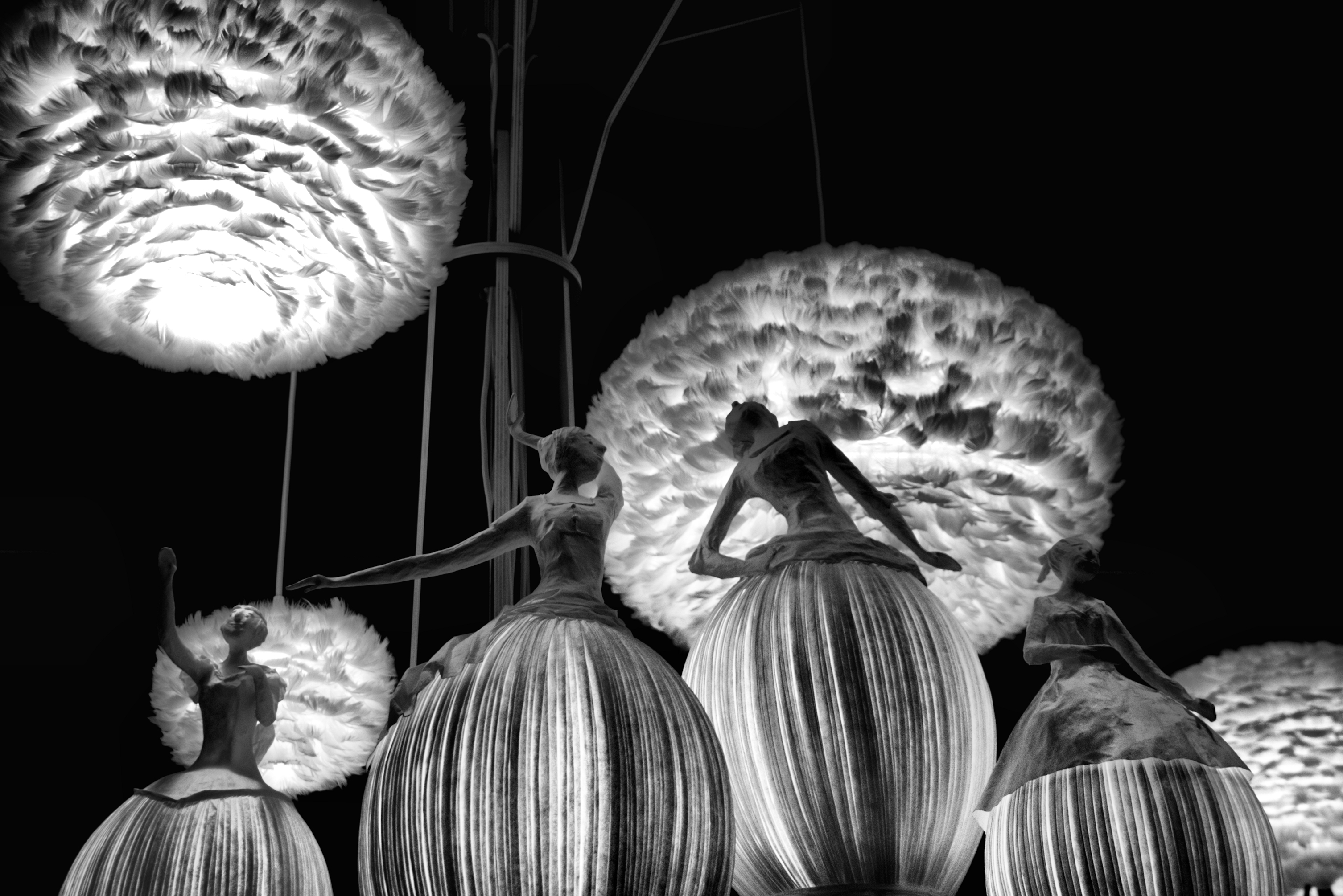 Blalack and white photo of ballerina statues dancing.
