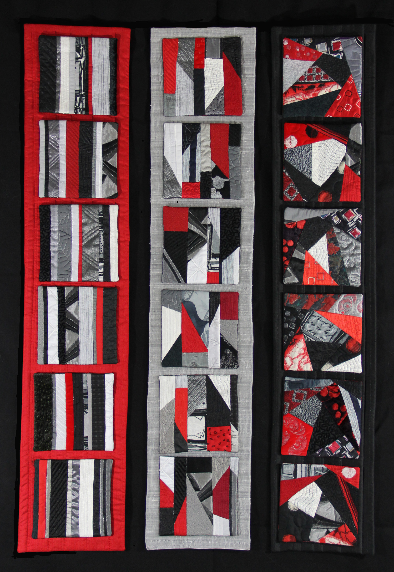3 panels on red, white or black silk with 6 small quiltlets attached by snaps on each evolving from simple to complex design