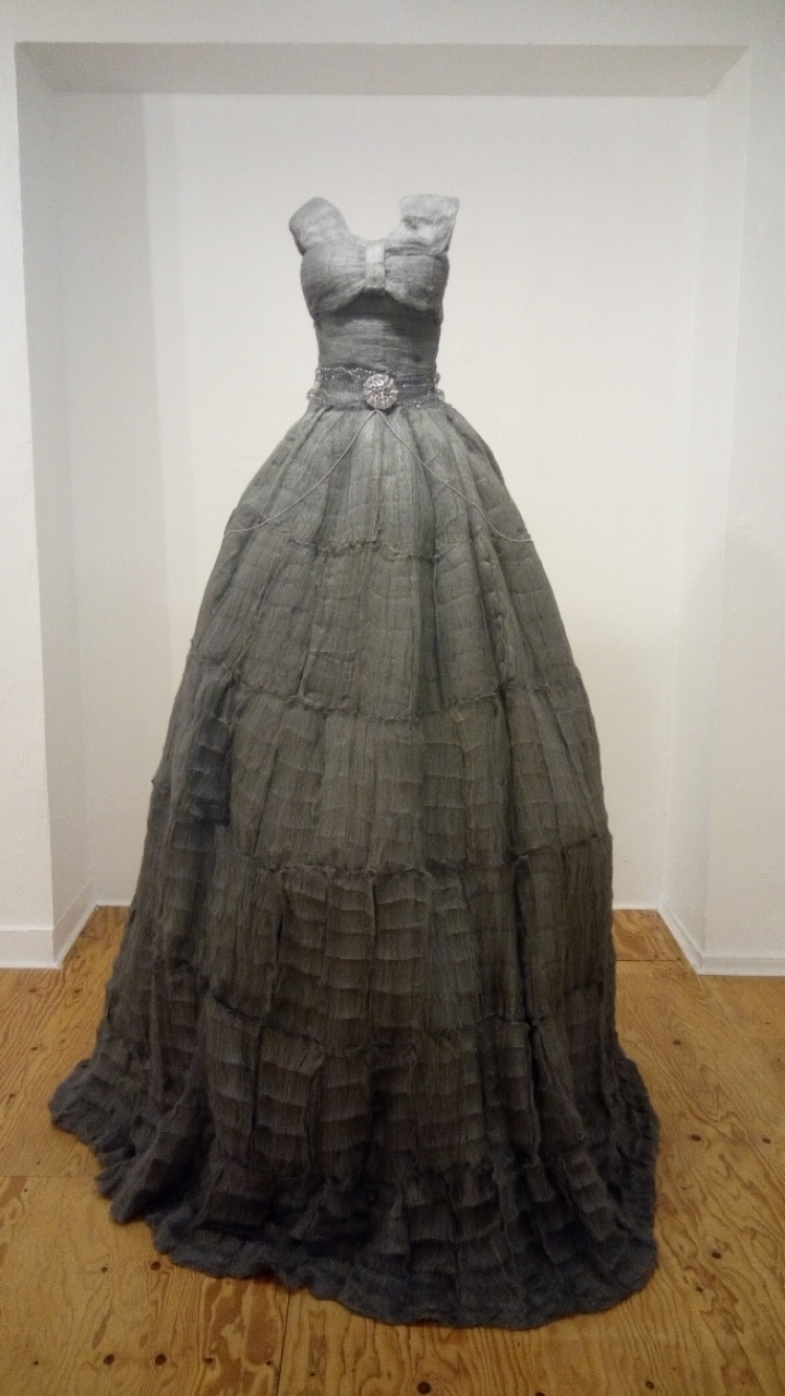 Elegant dress made of steel wool and other domestic materials