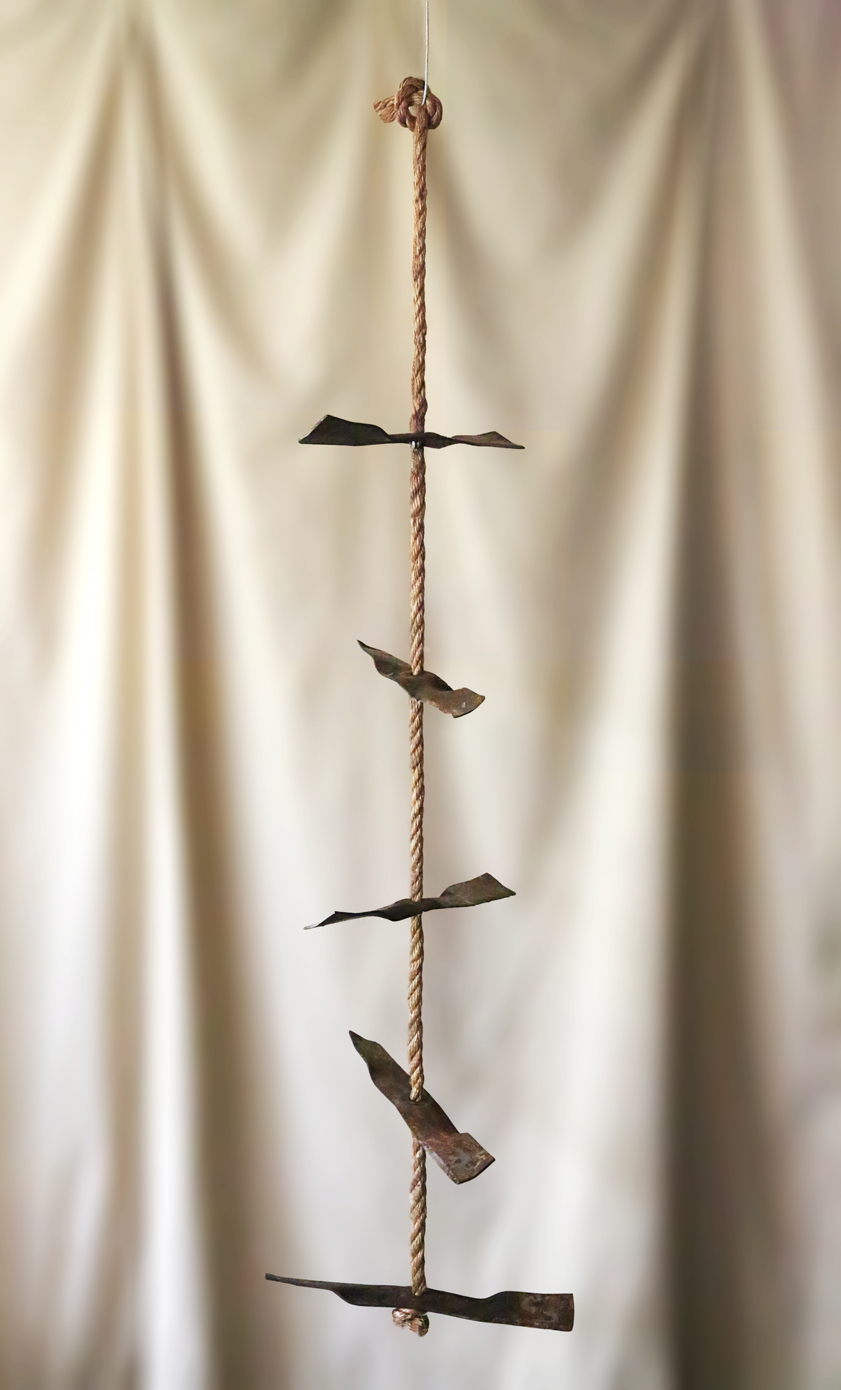 Mobile sculpture of abstract ladder with 5 salvaged tractor blades evenly spaced on single rope 6ft long