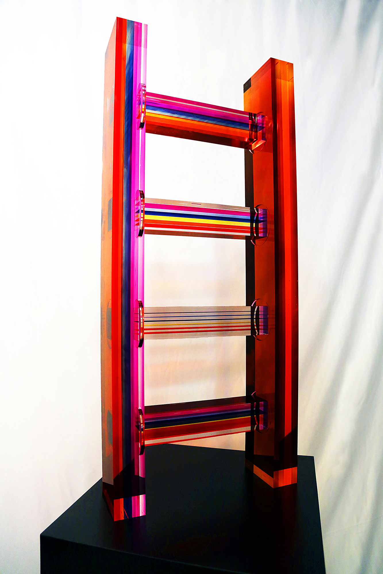 4 rung ladder sculpture made of rainbow infused acrylic