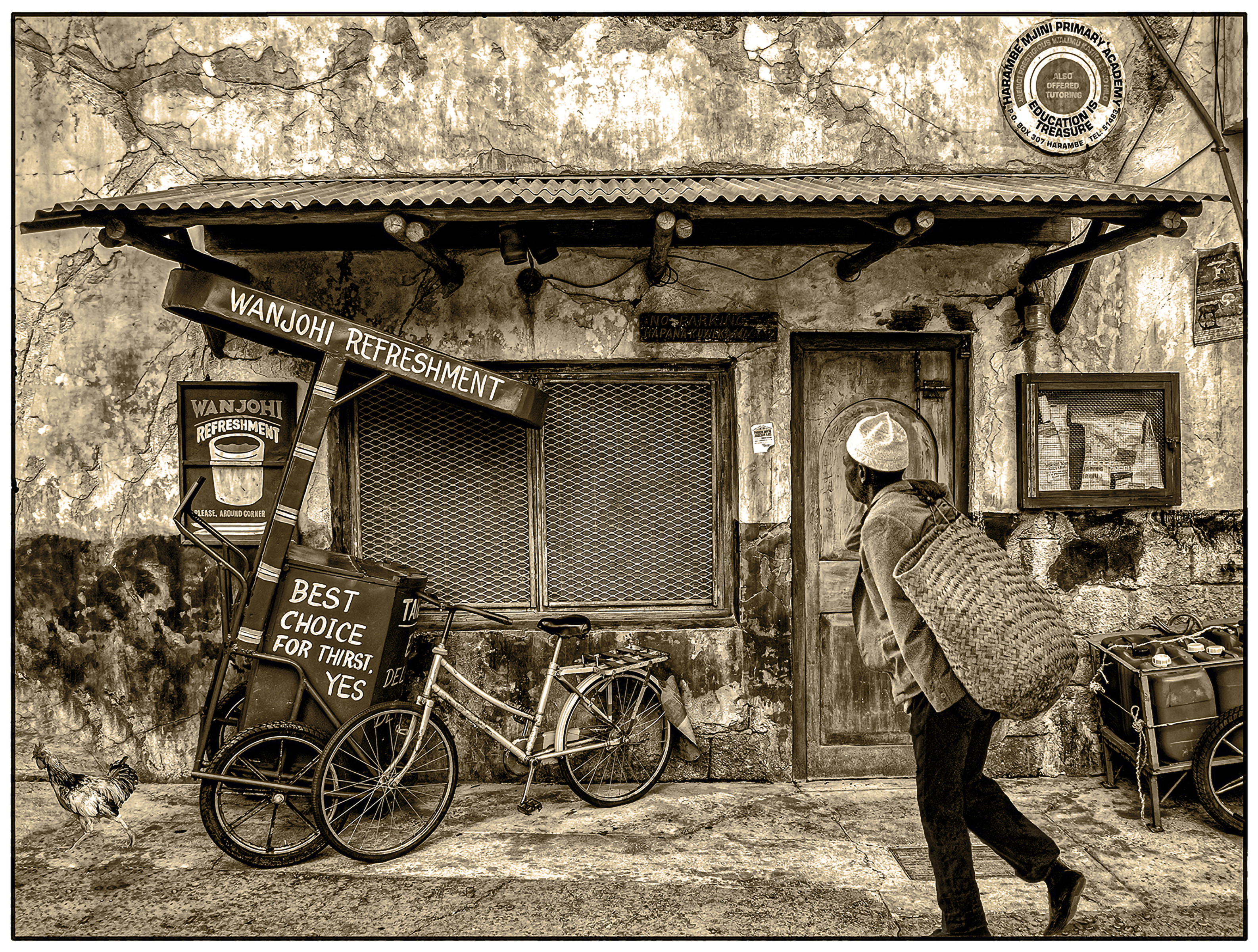 man with straw bag on his bak waling in front a shop.