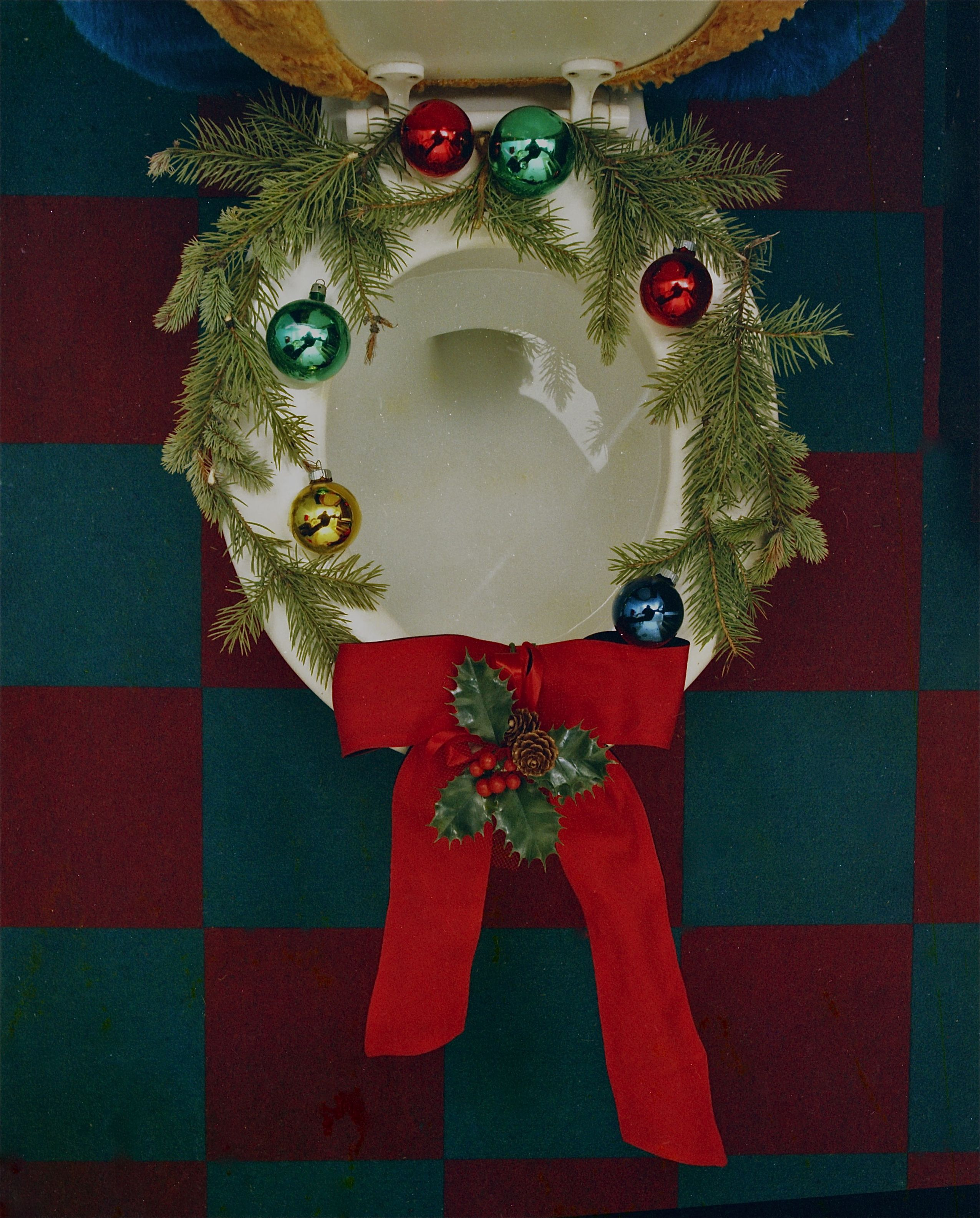Toilet seat decorated as a Xmas wreath