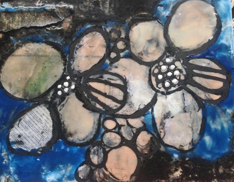 Blue and black layered flowers in wax and black acrylic