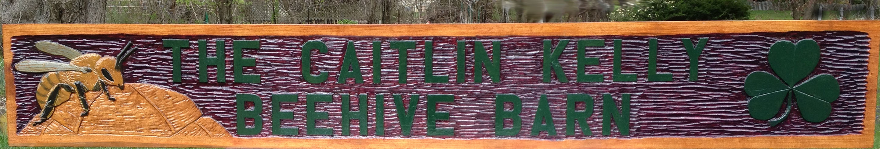 Hand-carved and painted wooden Sign
