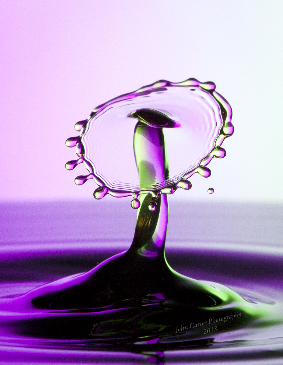 Two water drops colliding