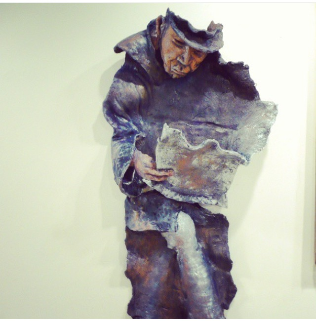 Man in blue sculpture