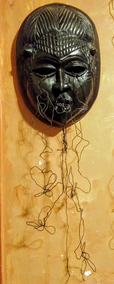 series of wire masks and objects