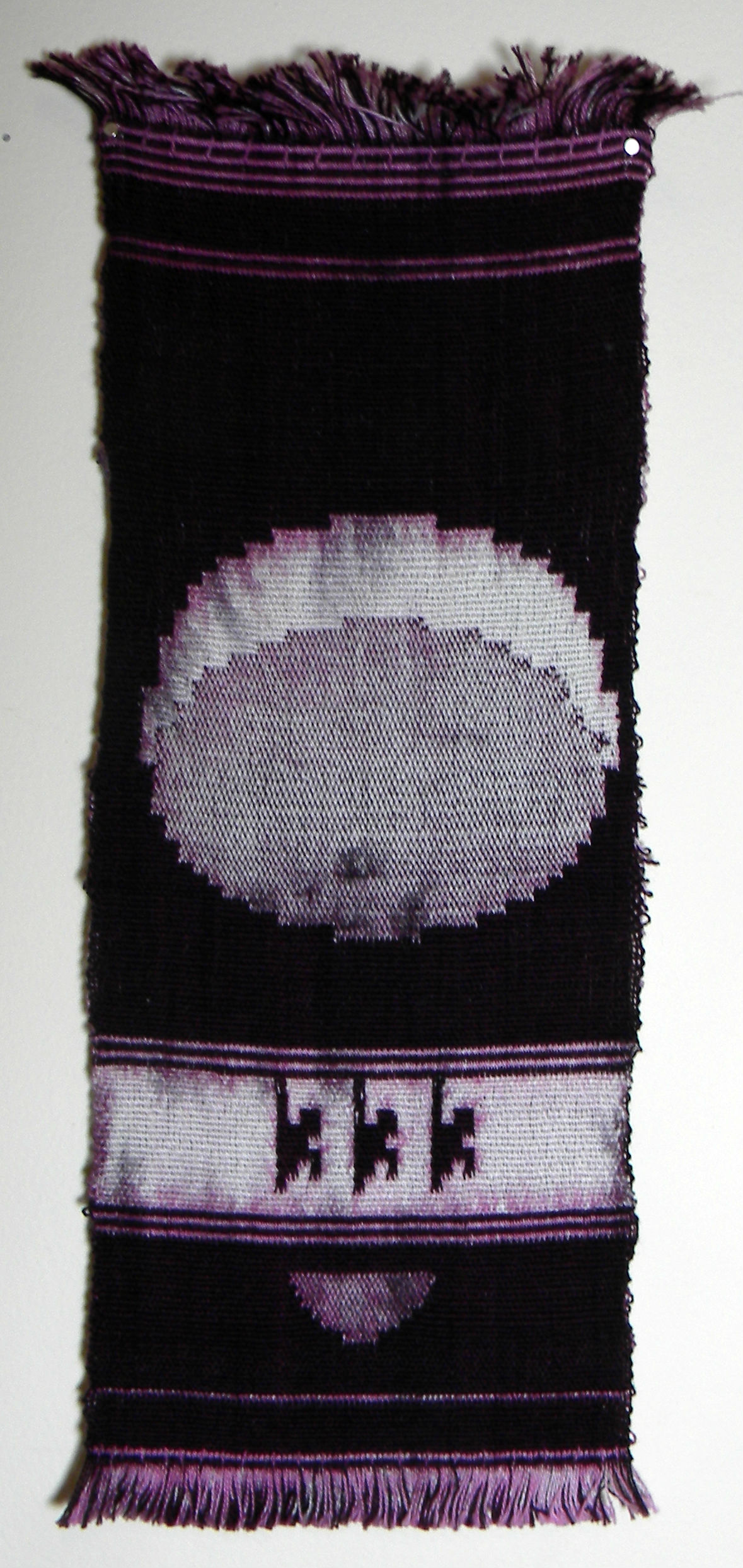a purple and off-white handwoven wall hanging handwoven by Clare Nicholls