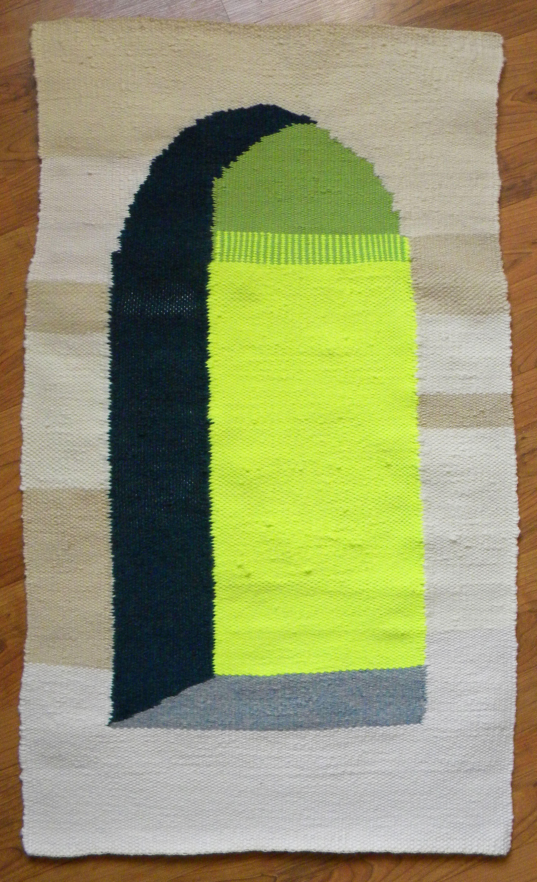 a yellow, green, and blue window, doorway, or arch; handwoven tapestry by Clare Nicholls