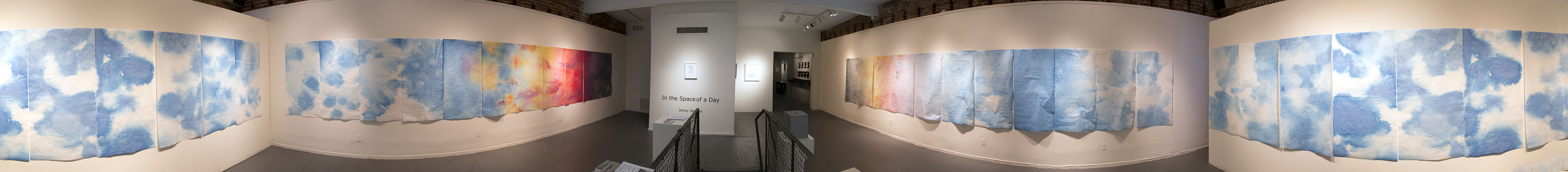 """In the Space of a Day"" a large 75 ft installation of watercolor that takes the viewer through movements in the day"