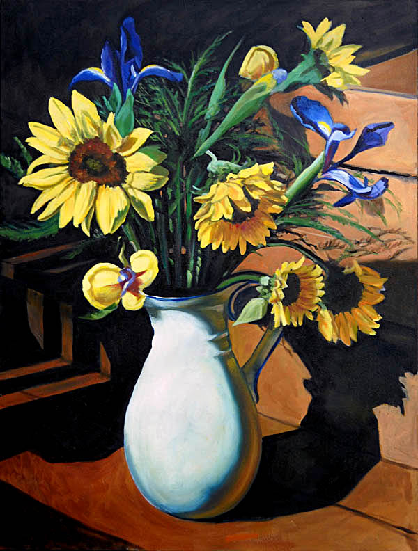 Sunflowers in white vase on wooden deck
