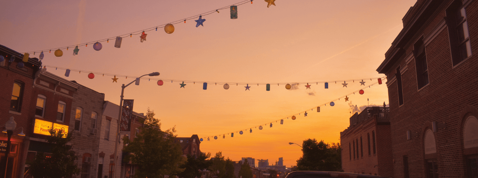 City street at sunset with hanging lanterns